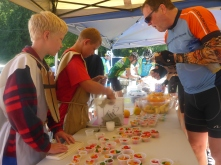 Boy Scout troop members dispensing treats