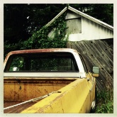 Old truck, old building, North Bend