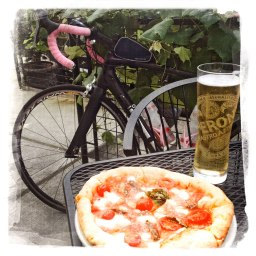 Post ride bliss. Timothy succumbed to the siren call of woodfired piza at Pizzeria Pulchinella.